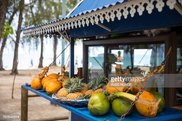 market fruit stall, mont choisy beach, mauritius - mauritius stock photos and pictures