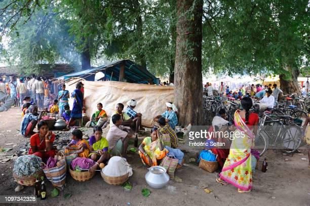 Market in Chhatisgarh State Women from the Muria tribe selling vegetables on November 20 2013 in Chhattisgarh India