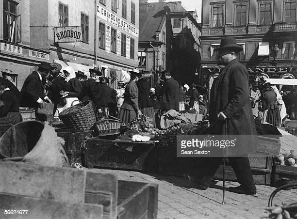 A market in Gamla Stan the old town of Stockholm at the convergence of Malartorget and Munkbrogatan streets circa 1910