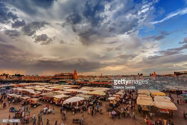 market on djemma el-fna square in marrakesh, morocco - djemma el fna square stock photos and pictures