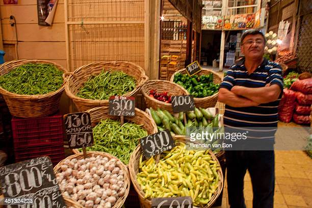 CONTENT] Market owner and his vegetables in Valparaiso Chile