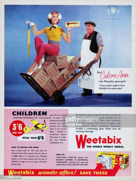 Market porter using a hand truck to push Calorie Ann, the Weetabix glow-girl, on a foggy street. Original Publication: Picture Post Ad - Vol 74 No 5...