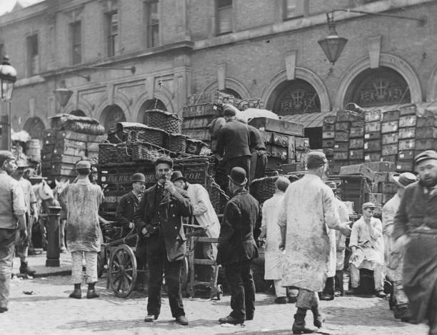 Market porters loading wagons with goods at Billingsgate...
