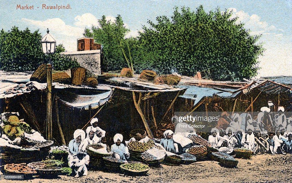 Market Rawalpindi India early 20th century Postcard showing market traders in Rawalpindi now in Pakistan