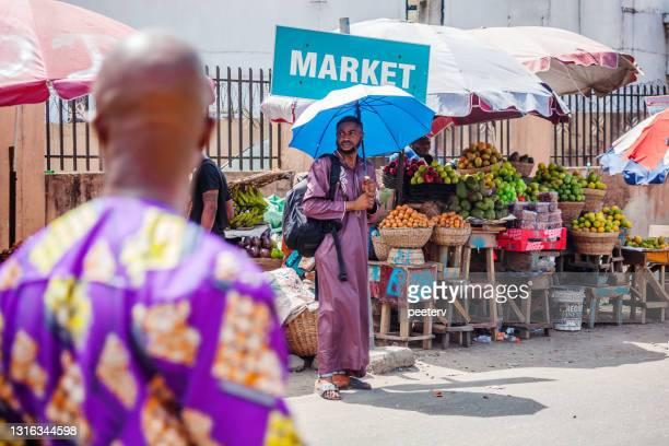 "market scene - lagos, nigeria - ""peeter viisimaa"" or peeterv stock pictures, royalty-free photos & images"