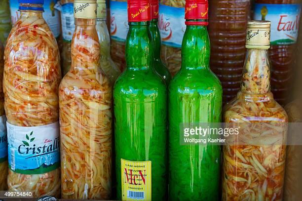 Market scene with hot sauce in plastic bottles in Antsiranana Madagascar