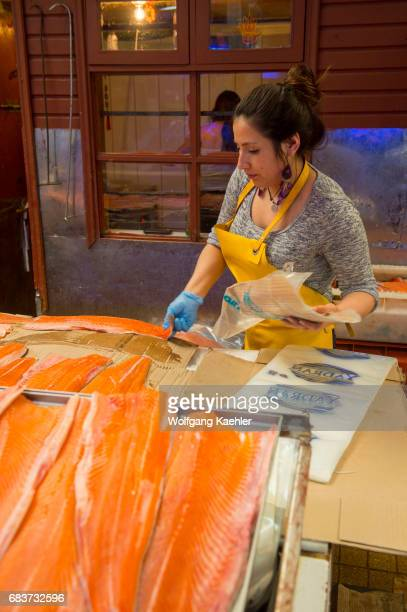 Market scene with woman selling salmon in the market hall in Angelmo Puerto Montt in southern Chile