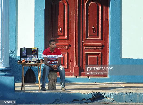CONTENT] A market seller waiting patiently for shoppers next to a makeshift display of the wares he has on offer Payment in Convertible Peso or CUC...