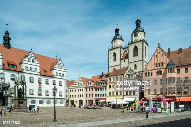 market square with town hall, at back parish church st. marien, luther city wittenberg, saxony-anhalt, germany - lutherstadt wittenberg stock pictures, royalty-free photos & images
