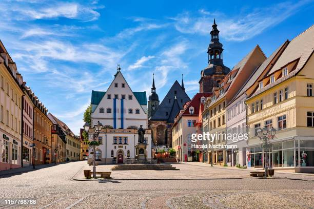 market square with town houses, town hall and monument of martin luther, lutherstadt eisleben, saxony-anhalt, germany - saxony anhalt stock pictures, royalty-free photos & images