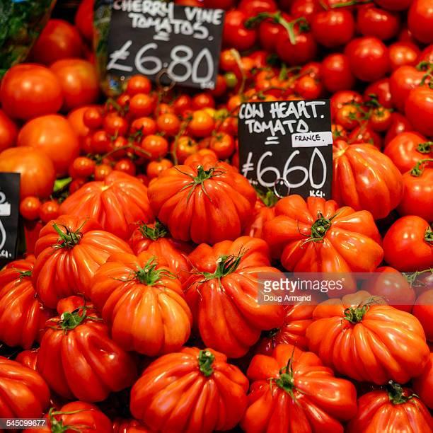 Market stall display of fresh tomatoes
