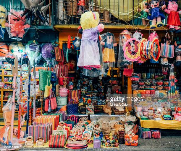 market stall filled with colorful items - mexico city stock pictures, royalty-free photos & images