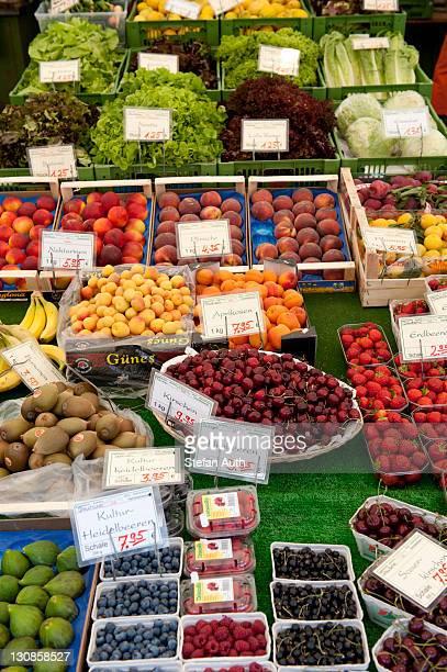 Market stall, fruit stand, nicely decorated various fruit, blueberries, raspberries, cherries, apricots, peaches and salad, Viktualienmarkt market, Munich, Upper Bavaria, Bavaria, Germany, Europe