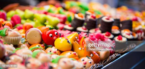 market stall full of candys at the boqueria in barcelona - marzipan stock pictures, royalty-free photos & images