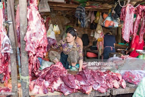Market stall holder selling meat at Phsar Kandal Market, Phnom Penh, Cambodia
