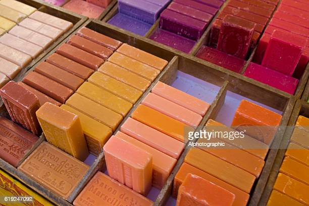 Market stall selling different soaps