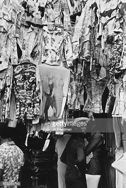 A market stall sells shirts and blouses with decorative printing in Lower East Side Manhattan New York City 1975