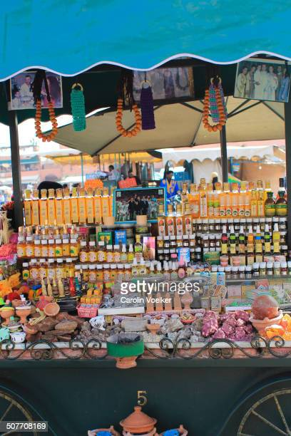 CONTENT] Market stand selling cosmetics lotions and herbal medicine on the main square Djeema el Fna Marrakech Morocco