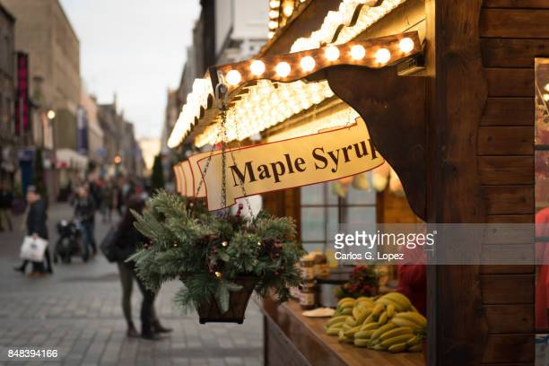 market stand selling maple syrup pancakes - outdoor christmas - christmas banner stock photos and pictures
