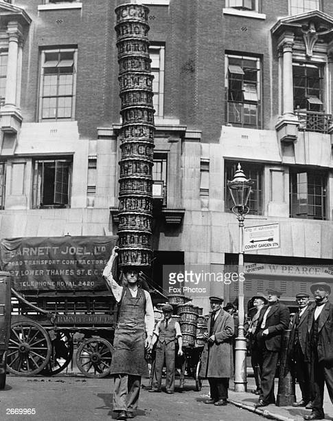 Market trader Alfred Bailey practising with 15 baskets at Covent Garden London for the basketcarrying championships at Herne Hill
