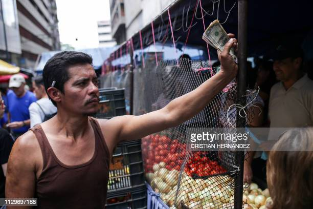 A market trader is seen in Caracas on March 10 during the third day of a massive power outage which has left Venezuelans without communications...