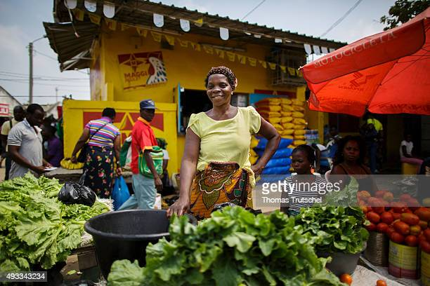 A market trader poses for a photo at her market stall in a street market on September 29 2015 in Beira Mozambique