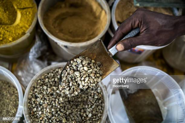 A market trader scoops a measure of coffee beans for a customer in Mombasa Kenya on Thursday Nov 23 2017 The countrys Treasury has already cut this...