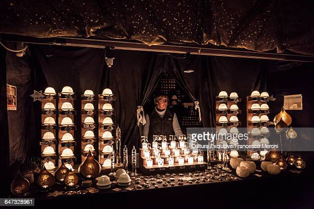 Market trader selling candle holders at Christmas market, Basel, Switzerland