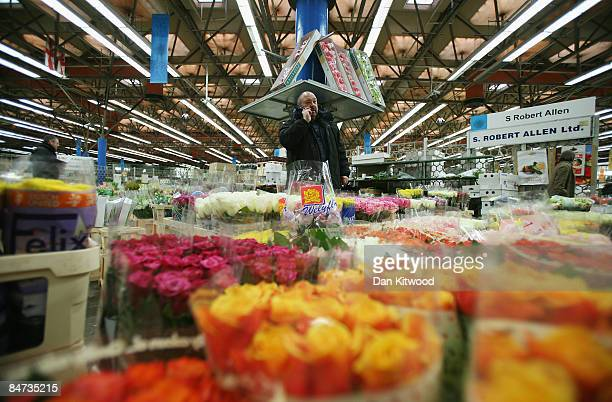 A market trader stands on his stall in New Covent Garden Flower Market on February 11 2009 in London England New Covent Garden Flower Market is...
