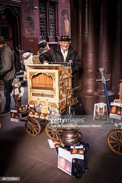 Market trader with cart at Christmas market, Basel, Switzerland