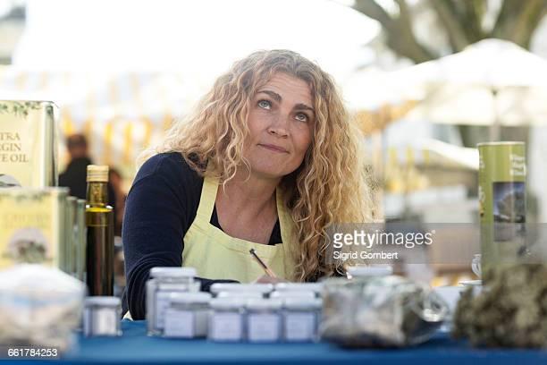 market trader with variety of olive oil produce - sigrid gombert - fotografias e filmes do acervo