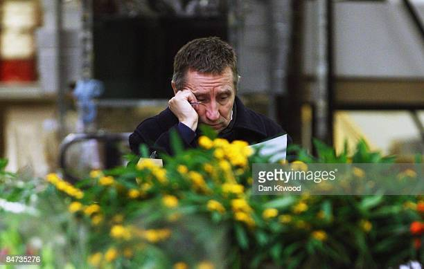 A market trader works at his stall in New Covent Garden Flower Market on February 11 2009 in London England New Covent Garden Flower Market is...