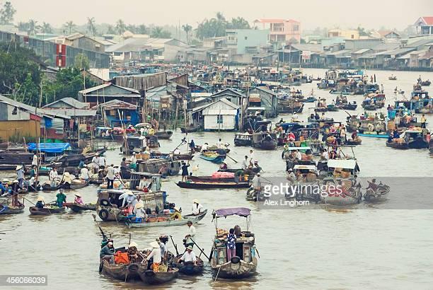 Market traders at floating market, Vietnam