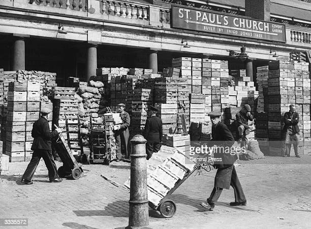 Market traders load their carts outside Covent Garden Market in London