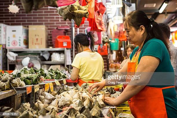 A market vendor arranges rice dumplings