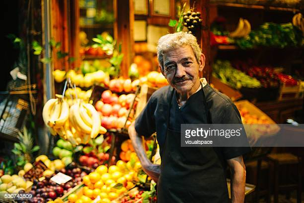 market vendor - happy merchant stock pictures, royalty-free photos & images