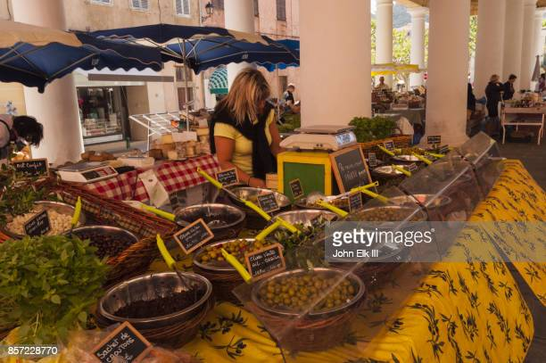 Market vendor selling olives