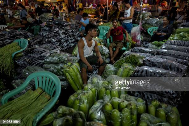 Market vendors endors selling vegetables inside plastic bags on April 5 2018 in Manila Philippines The Philippines has been ranked third on the list...