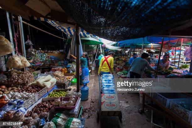 market vendors. - laotian culture stock pictures, royalty-free photos & images