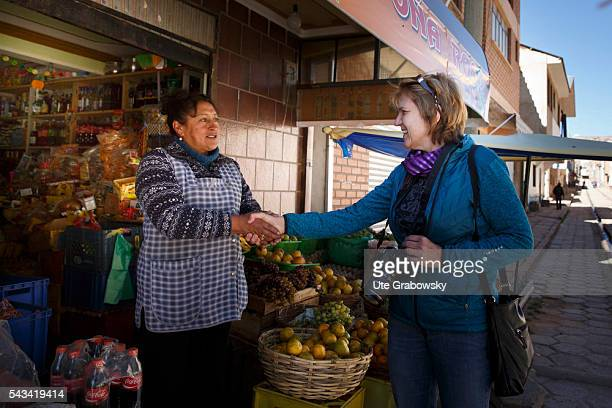 A market woman adopted a tourist at a fruit stand in Sacaca a small town in the Andes of Bolivia on April 15 2016 in Sacaca Bolivia