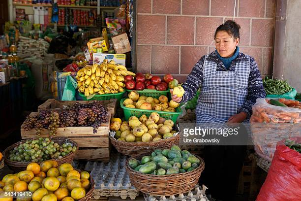 Market woman at a fruit stand in Sacaca a small town in the Andes of Bolivia on April 15 2016 in Sacaca Bolivia