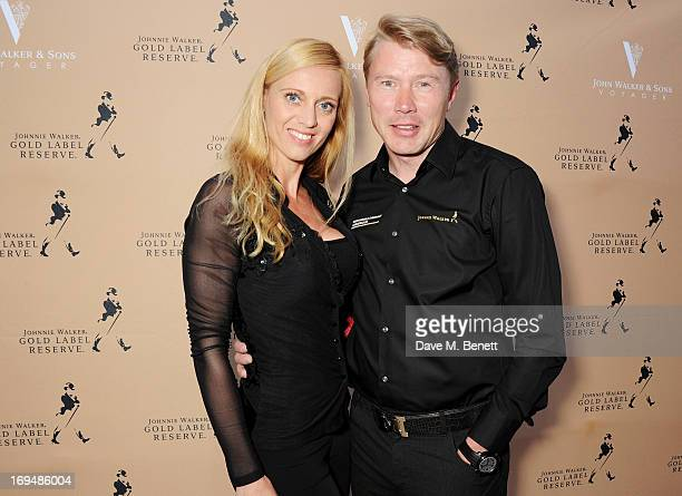 Marketa Kromatova and Twotime Formula One World Champion Mika Hakkinen attend the Johnnie Walker Gold Label Reserve cocktail party aboard the John...