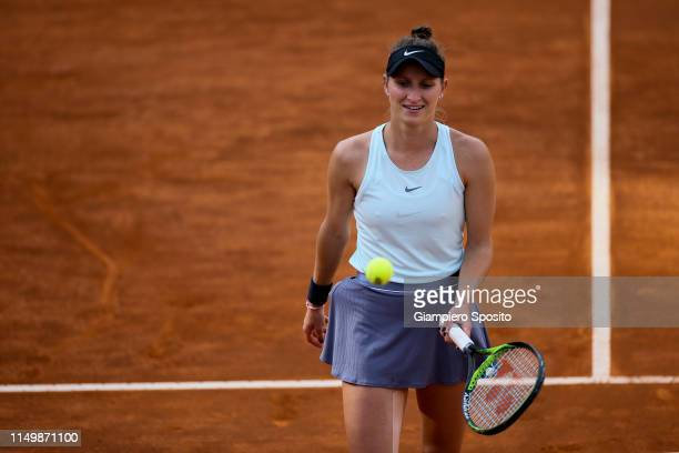 Marketa Vondrousova of Czech Republic prepares to serve against Johanna Konta of Great Britain in their Women's Single Quarterfinal Match during Day...