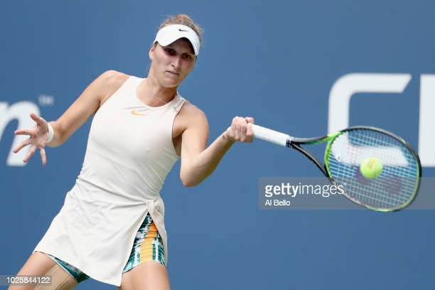 Marketa Vondrousova of Czech Republic returns the ball during her women's singles third round match against Kiki Bertens of the Netherlands on Day...