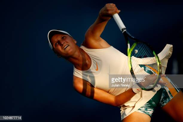 Marketa Vondrousova of Czech Republic serves the ball during her women's singles first round match against Mona Barthel of Germany on Day Two of the...