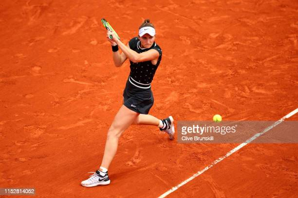 Marketa Vondrousova of The Czech Republic plays a backhand during her ladies singles third round match against Carla Suarez Navarro of Spain during...