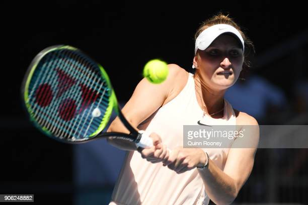 Marketa Vondrousova of the Czech Republic plays a backhand in her second round match against Caroline Garcia of France on day four of the 2018...