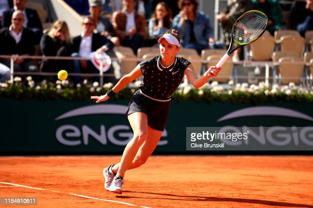 Marketa Vondrousova of The Czech Republic plays a forehand during the ladies singles final against Ashleigh Barty of Australia during Day fourteen of...