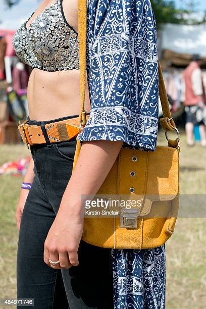 Marketing Assistant Bethan Mitchell wears a Golden Bear belt and Bra Top Top shop jeans Little Boy blue bag Urban Outfitters Kimono on day 2 of the...