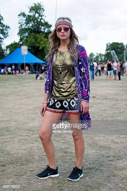 Marketing assistant Rebecca Sumner wearing a Beyond Retro jacket and sunglasses Maje top Zara shorts and Nike trainers at Wilderness Festival on...